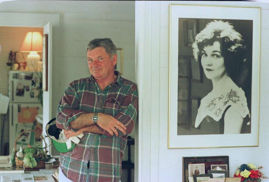 Owner David Bland is shown in the childhood home of the late Katherine Anne Porter Wednesday, Feb. 25, 1998, in Kyle, Texas. A portrait of the author is at right. Porter was a Pulitzer Prize-winning journalist, essayist and novelist. (AP Photo/Harry Cabluck) Photo: HARRY CABLUCK, AP / AP