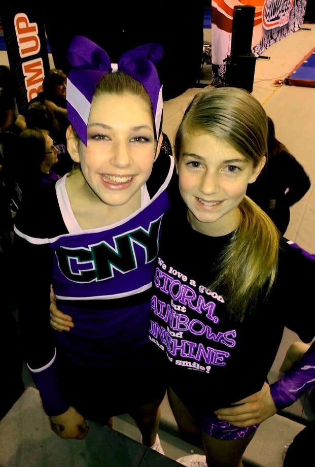 Emily Maye and her \'cheer sister\' Emmaleigh Fredenburg of the CNY Rainbows cheer team, at the Spirit Unlimited competition on Saturday, April 6, 2013, at University at Albany in Albany, N.Y. (Photo Courtesy Of Melissa Maye)