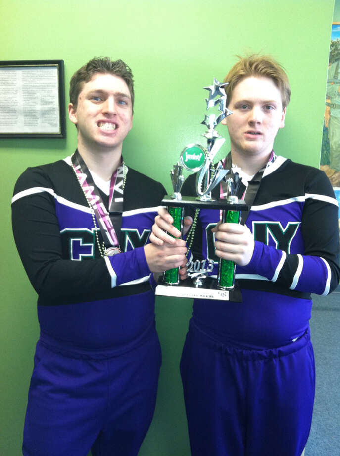 Eddie Vendetti and Christian Grugan participate on the CNY Rainbows cheer team, at the Spirit Unlimited competition on Saturday, April 6, 2013, at University at Albany in Albany, N.Y. (Photo Courtesy Of Diane Grugan-Duvall)