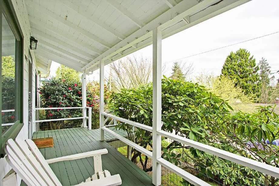 Front porch of 10461 Waters Ave. S. The 1,598-square-foot house, built in 1928, has three bedrooms, one bathroom and a covered back patio on a 5,650-square-foot lot. It's listed for $299,000, although a sale is pending. Photo: Courtesy Su Harambe/Windermere Real Estate