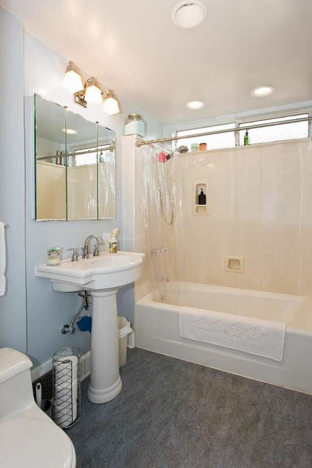 Bathroom of 10461 Waters Ave. S. The 1,598-square-foot house, built in 1928, has three bedrooms, one bathroom, a front porch and a covered back patio on a 5,650-square-foot lot. It's listed for $299,000, although a sale is pending. Photo: Courtesy Su Harambe/Windermere Real Estate
