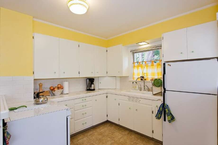 Kitchen of 10461 Waters Ave. S. The 1,598-square-foot house, built in 1928, has three bedrooms, one bathroom, a front porch and a covered back patio on a 5,650-square-foot lot. It's listed for $299,000, although a sale is pending. Photo: Courtesy Su Harambe/Windermere Real Estate