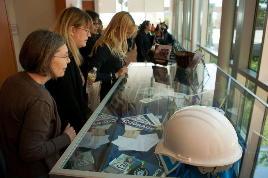Items that will soon be buried in 25- and 100-year time capsules at Northeast Lakeview College are the center of attention during the college's fifth anniversary celebration Friday. Photo: Tom Raymond / Northeast Lakeview