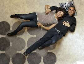 Melina and Dodd Raissina of Peace Industry lie on their Flicker rug on Tuesday, April 9, 2013 in San Francisco, Calif.