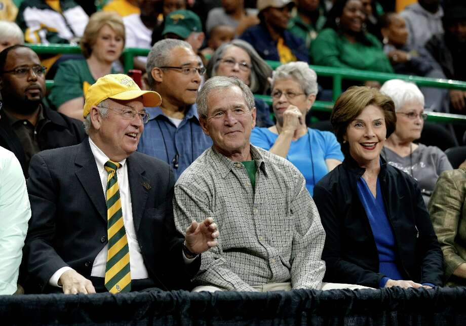 Baylor university president Ken Starr, left, talks with former President George W. Bush and Laura before a second-round game against Florida State in the women's NCAA college basketball tournament Tuesday, March 26, 2013, in Waco, Texas. Baylor won 85-47. (AP Photo/Tony Gutierrez) Photo: Tony Gutierrez, Associated Press / AP