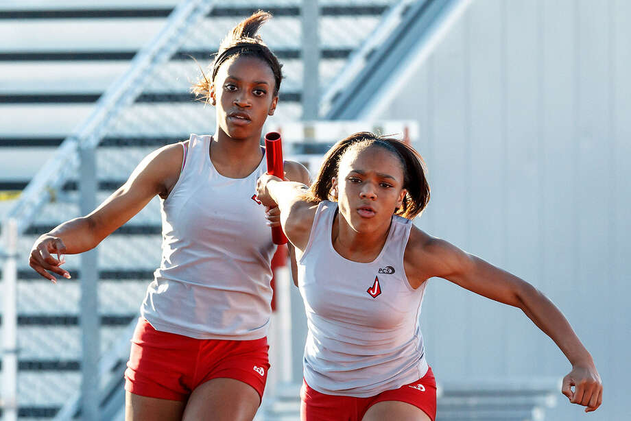 Judson's Konstance James (right) takes the handoff from Kiana Horton for the third leg of the 800-meter relay April 4 during the Thunderbird Relays at Rutledge Stadium. Judson won the event with a time of 1:41.42. Judson's girls' team were the meet champions. Photo: Marvin Pfeiffer / NE Herald