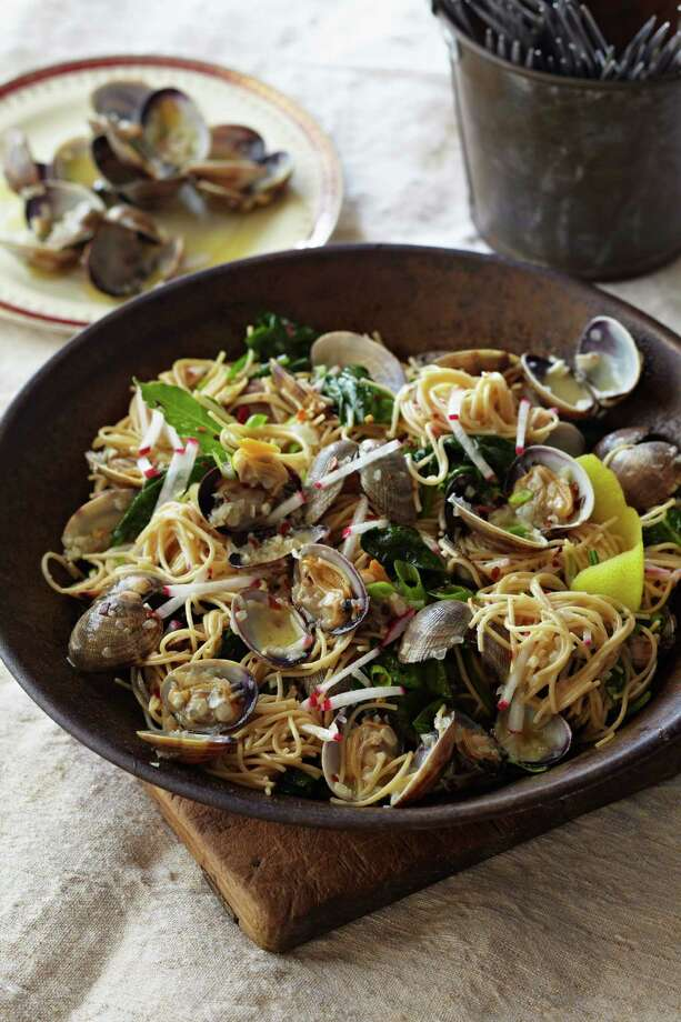 "Angel Hair Pasta with Clams, Radishes and Spinach is among the recipes in ""What's for Dinner? Delicious Recipes for a Busy Life"" by Curtis Stone. Photo: Ballantine Books"