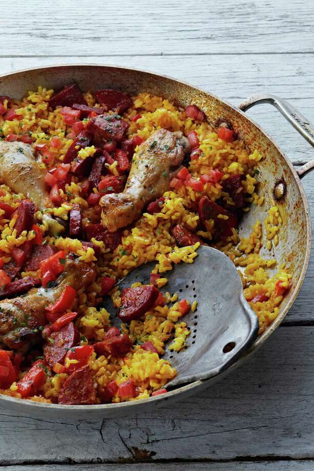 Chicken and chorizo paella will taste delicious at any time of day. Get the recipe here. Photo: Ballantine Books