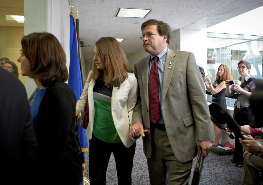 Bill Sherlach, with daughter Maura Schwartz, arrives with other families of the Newtown, Conn., massacre to meet on Capitol Hill with Connecticut's senators. His wife, Mary Sherlach, a school psychologist, was a victim of the shootings. Photo: J. Scott Applewhite, STF / AP