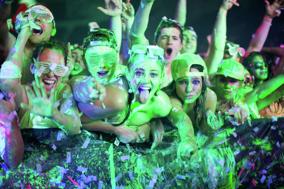"""Life in Color (formerly Dayglow), which calls itself the """"World's Largest Paint Party,"""" came to Hartford, Conn., last year, as seen in this scene, bringing vats of paint, electronic music, performers and a multisensory experience to the crowd. It comes to Bridgeport, Conn., for the first time with a show Thursday, April 11, 2013 at the Webster Bank Arena. For more information on showtime and tickets, visit http://www.websterbankarena.com. Photo: Contributed Photo / Stamford Advocate Contributed"""