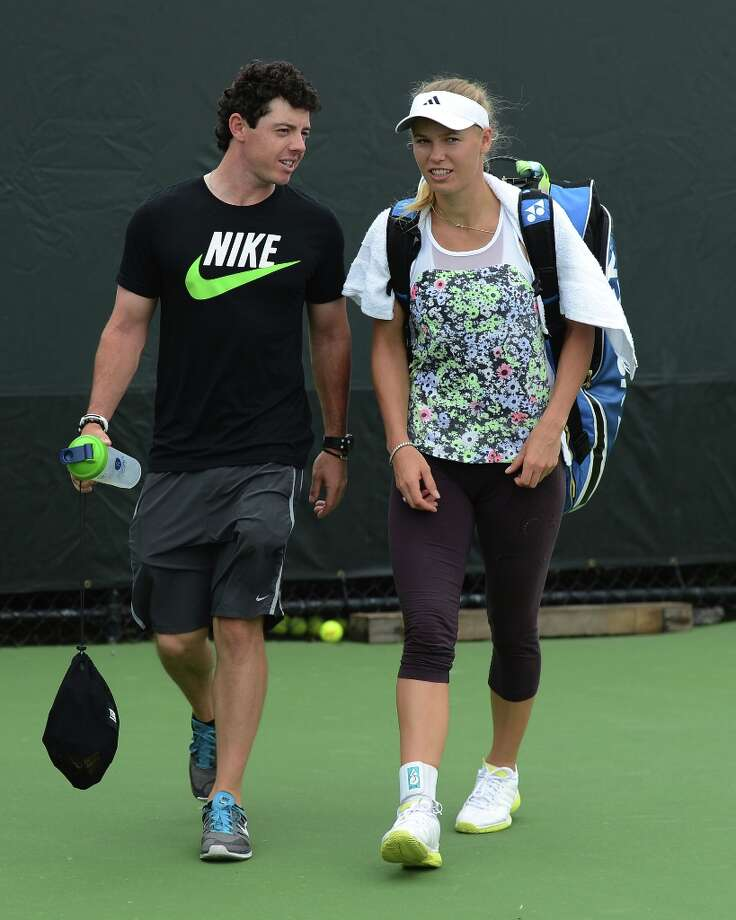 Rory McIlroy and Caroline Wozniacki are sighted at the Sony Tennis Open 2013 at Crandon Park Tennis Center on March 19, 2013 in Key Biscayne, Florida. Photo: Uri Schanker, FilmMagic / 2013 Uri Schanker