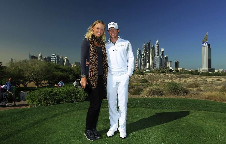 Rory McIlroy of Northern Ireland with his girlfriend Caroline Wozniacki of Denmark the World\'s Number One female tennis player during his practice round as a preview for the 2012 Omega Dubai Desert Classic on the Majilis Course at the Emirates Golf Club on February 7, 2012 in Dubai, United Arab Emirates. Photo: David Cannon, Getty Images / 2012 Getty Images