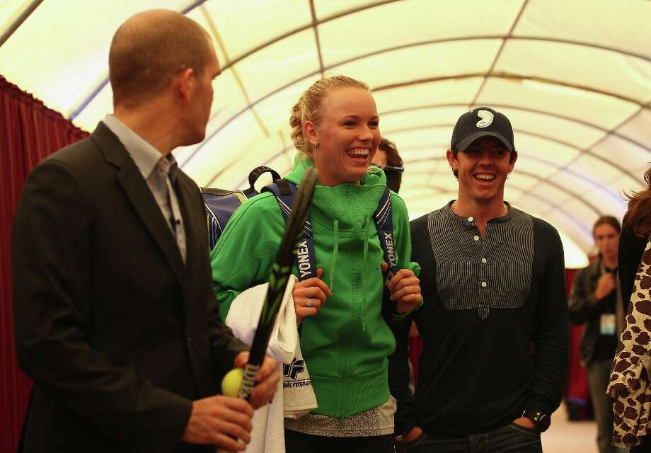 Caroline Wozniacki of Denmark and Rory McIlroy, Northern Ireland Golfer arrive at the practice court next to the Sinan Erdem Stadium during previews for the WTA Championships 2011 on October 22, 2011 in Istanbul, Turkey. Photo: Julian Finney, Getty Images / 2011 Getty Images