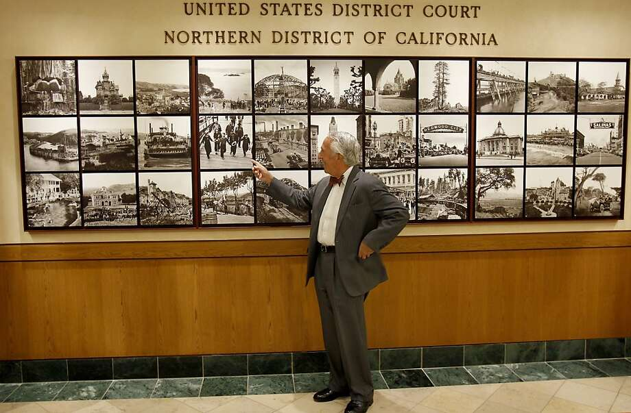 Federal District Judge Charles Breyer points out a Dorothea Lange photo at the Phillip Burton Federal Building in S.F. Photo: Brant Ward, The Chronicle