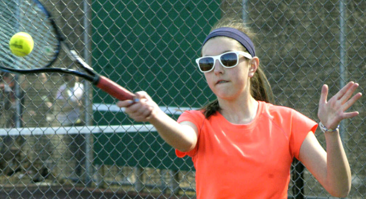 Amanda Aguayo of the Green Wave sports fashionable shades as she fine-tunes her game for New Milford HIgh School girls' tennis, April 2013