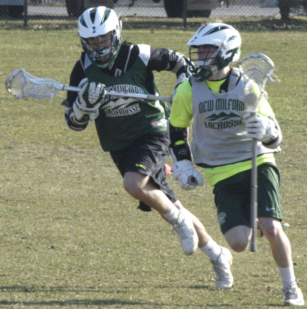 Blaine McMahon and A.J. McDonald of the Green Wave go at it 100 percent during practice for New Milford High School boys' lacrosse, April 2013