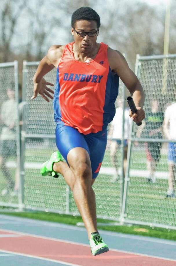 Danbury High School senior Micaiah Hill comes to the line in the 4X100 relay in the boys track meet at Danbury. Tuesday, April 9, 2013 Photo: Scott Mullin