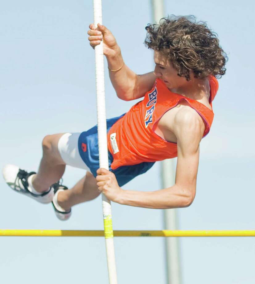Danbury High School sophomore Alex Troche clears the bar in the pole vault event in the boys track meet at Danbury. Tuesday, April 9, 2013 Photo: Scott Mullin