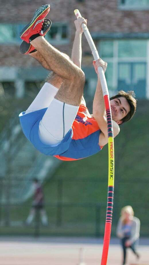 Danbury High School junior Antonio Topete begins his pole vault ascent to the bar in the boys track meet at Danbury. Tuesday, April 9, 2013 Photo: Scott Mullin / The News-Times Freelance