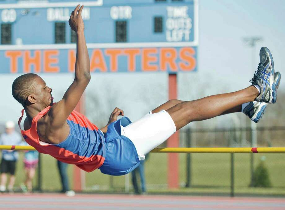 Danbury High School sophomore Hasan Culver sails over the high jump bar in the boys track meet at Danbury. Tuesday, April 9, 2013 Photo: Scott Mullin / The News-Times Freelance