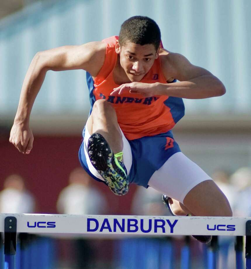 Danbury High School junior Tyrice O'Connor clears the last hurdle in the 110-meter event at the boys track meet in Danbury. Tuesday, April 9, 2013 Photo: Scott Mullin / The News-Times Freelance