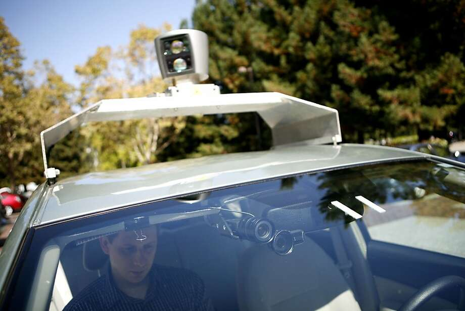 Google engineer Dmitri Dolgov is a passenger in one of the company's self-driving cars being tested in 2010. Photo: Ramin Rahimian, NYT