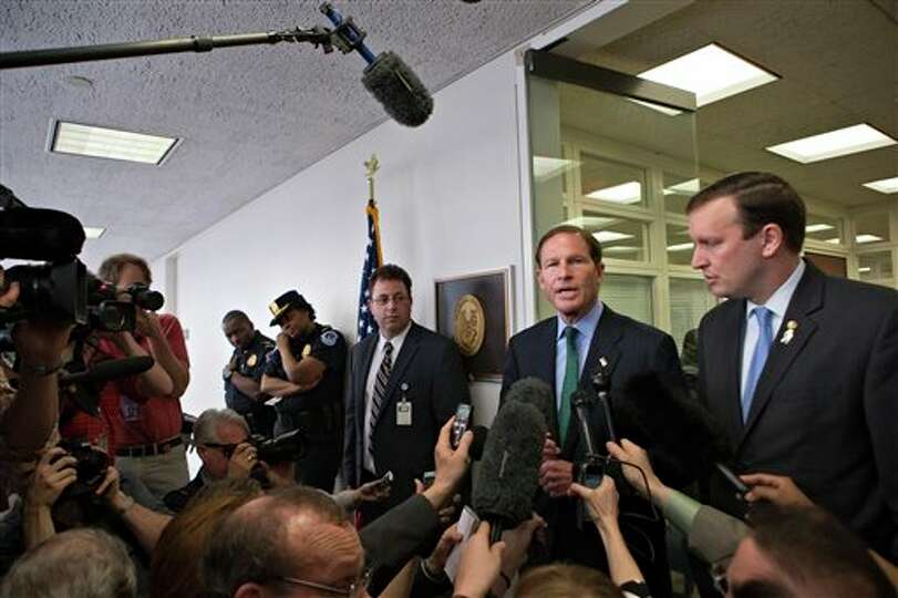 Sen. Richard Blumenthal, D-Conn., second from right, accompanied by Sen. Chris Murphy, D-Conn., righ