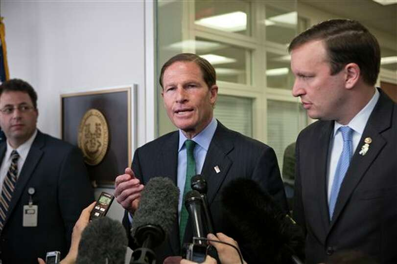 Sen. Richard Blumenthal, D-Conn., left, and Sen. Chris Murphy, D-Conn., right, speak to reporters af