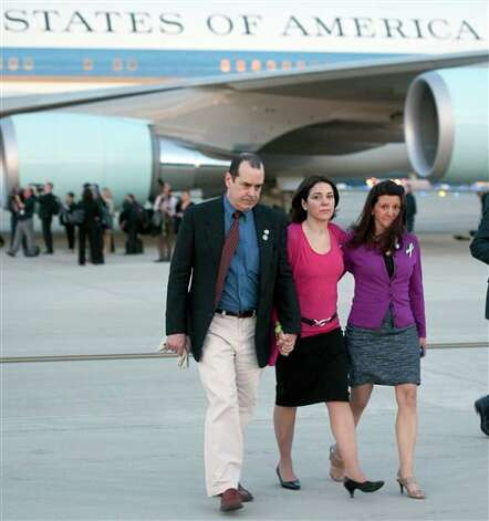 Jennifer Hensel, mother of 6 year-old Avielle, right, walks with Ben and Cheyanne Wyatt, parents of 6 year-old Allison, along with other members of families who lost relatives in the Sandy Hook Elementary School shooting in Newtown, Conn., from Air Force One to waiting White House vans after landing with President Barack Obama at Andrews Air Force Base, Md., on Monday April 8, 2013. . Obama was returning from Hartford, Conn., where he spoke at the University of Hartford, near the state capitol where last week the governor signed into law some of the nation's strictest gun control laws. (AP Photo/Cliff Owen) Photo: Cliff Owen, AP / Associated Press