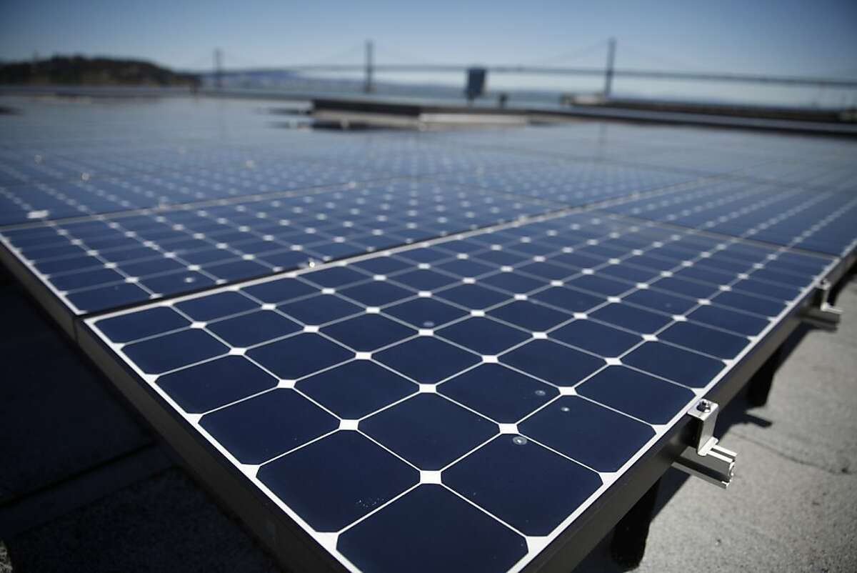 Solar panels are seen on top of the new Exploratorium on Tuesday, April 9, 2013 in San Francisco, Calif. The 1.3-megawatt (AC) SunPower solar power system is designed to help the Exploratorium to achieve its 'net-zero energy' goal. The system will generate 1.4 megawatts of DC, or direct current, electricity on the roof and use an inverter to convert it into 1.3 megawatts of AC, or alternating current, electricity for use in the building.