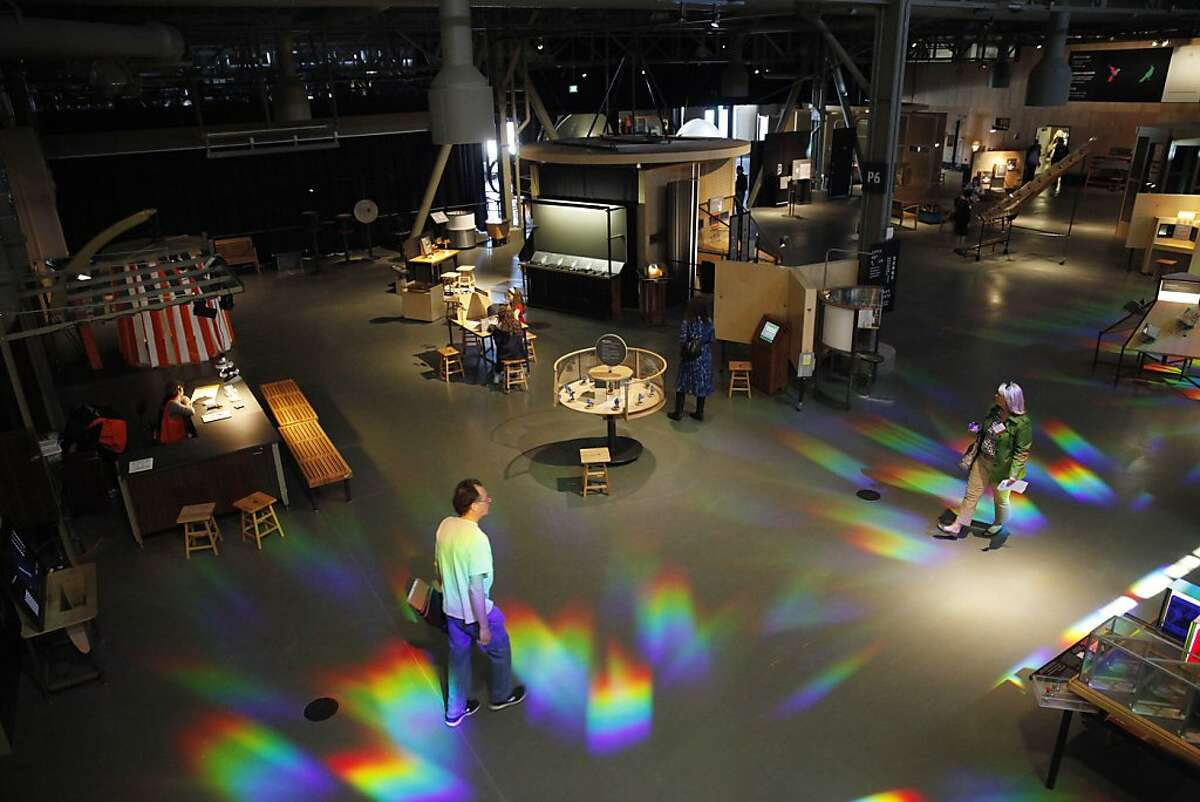 People walk through the Bechtel Central Gallery at the new Exploratorium on Tuesday, April 9, 2013 in San Francisco, Calif.