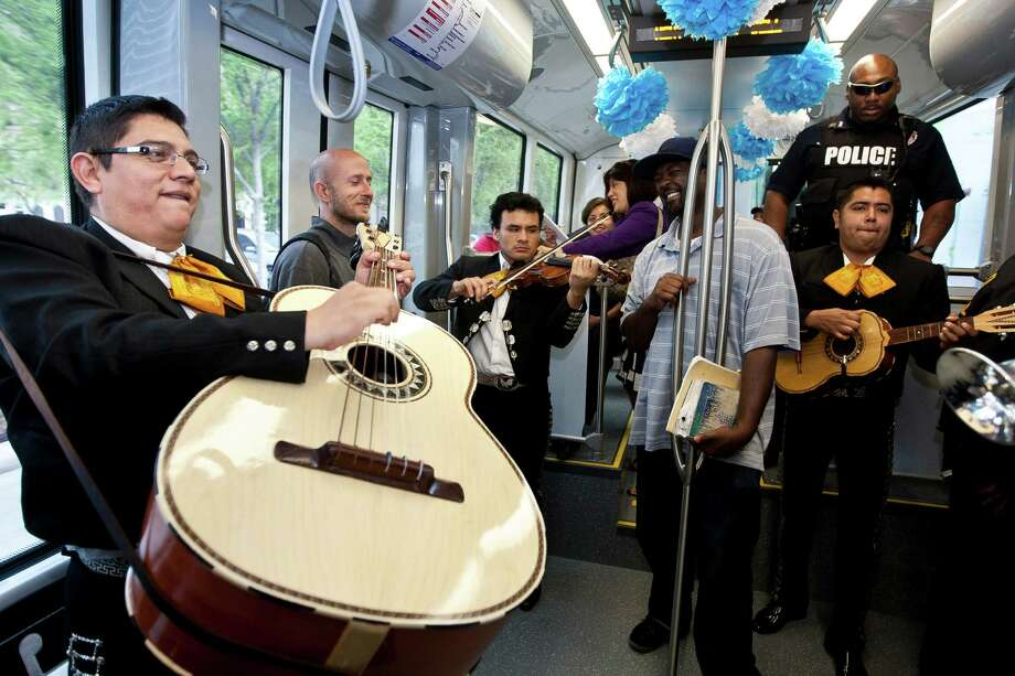 Edgar Casares, a guitar on player with Mariachi Calmecac, plays with his grupo during METRORail's 100 millionth boarding celebration, Tuesday, April 9, 2013, in Houston. METRORail used a newly commissioned S70 vehicle to make a small trip from Downtown UH to the Downtown Transit Center for a special celebration. Photo: Nick De La Torre, Chronicle / © 2013 Houston Chronicle
