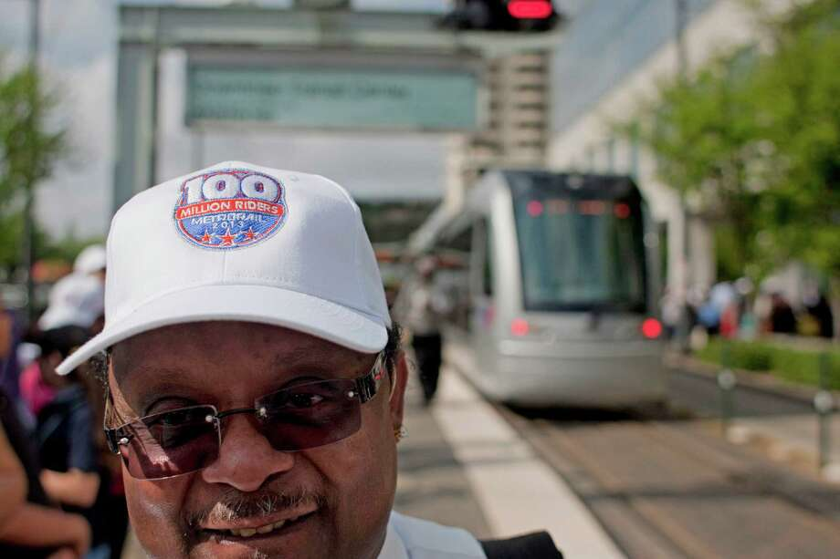 "METRO employee Marc Reaux wears a hat reading  ""100 million riders"" as METRORail celebrated 100 million boardings since service began in January 2004 at the Downtown Transit Center stop Tuesday, April 9, 2013, in Houston. Photo: Johnny Hanson, Houston Chronicle / © 2013  Houston Chronicle"