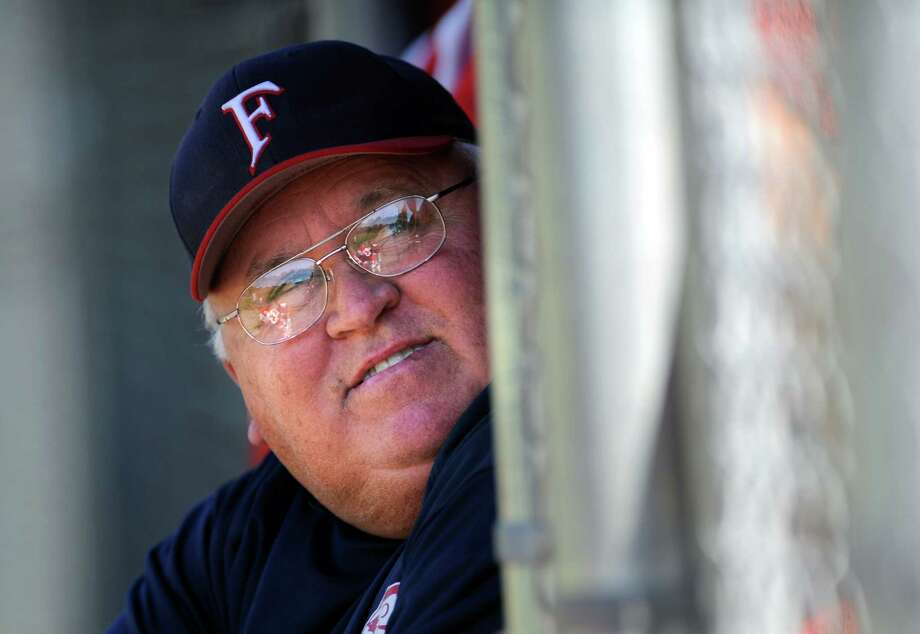 Foran baseball coach Ken Walker watches game action against Jonathan Law Thursday, May 12, 2011. Photo: Autumn Driscoll, ST / Connecticut Post