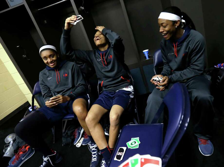 Connecticut's Morgan Tuck, Moriah Jefferson and Brianna Banks play cards in the locker room before practice for the women's NCAA Final Four college basketball tournament final, Monday, April 8, 2013, in New Orleans. UConn plays Louisville in the championship game on Tuesday.  (AP Photo/Gerald Herbert) Photo: AP