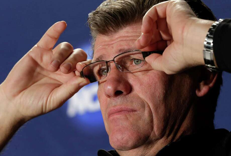 Connecticut head coach Geno Auriemma adjusts his glasses during a news conference for the women's NCAA Final Four college basketball tournament final, Monday, April 8, 2013, in New Orleans. UConn plays Louisville in the championship game on Tuesday.  (AP Photo/Dave Martin) Photo: AP