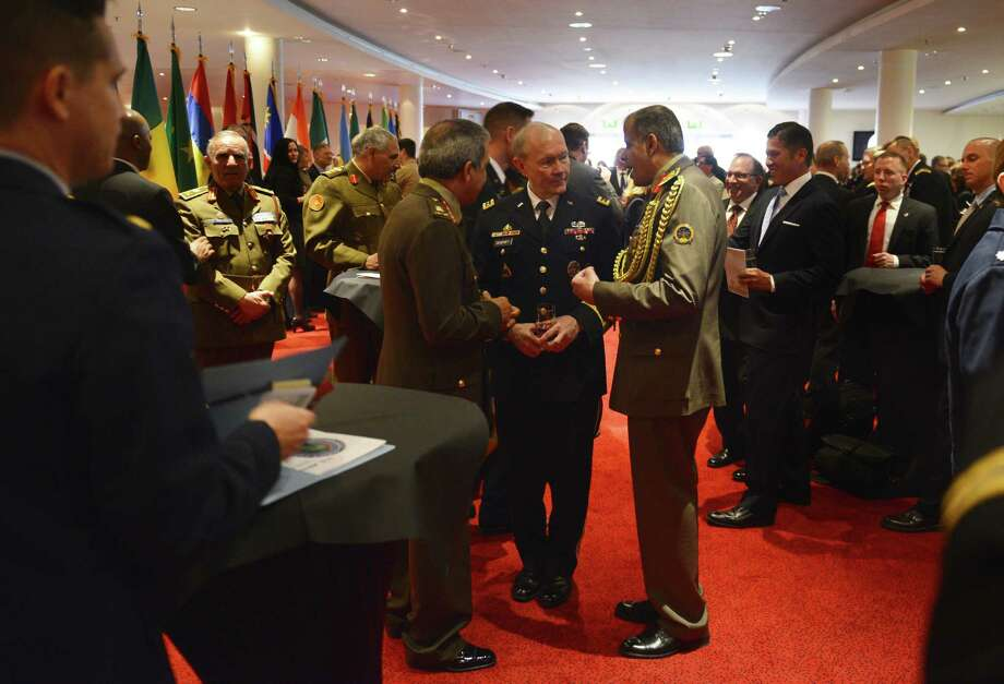U.S. Army Gen. Martin E. Dempsey, chairman of the Joint Chiefs of Staff, center, talks with Egyptian army generals Friday after the U.S. Africa Command change-of-command ceremony in Stuttgart, Germany. Photo: DOD