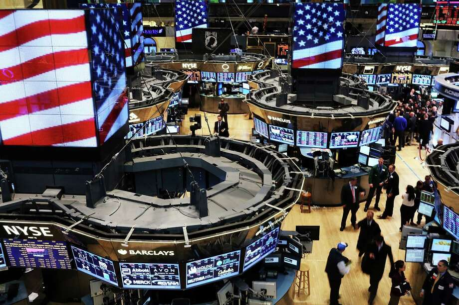 Traders work on the floor of the New York stock Exchange on April 5, 2013 in New York City.  Materials and energy companies led the stock market higher Tuesday, April 9, sending the Dow Jones industrial average to its second all-time high in a week. Photo: Spencer Platt, Getty Images / 2013 Getty Images