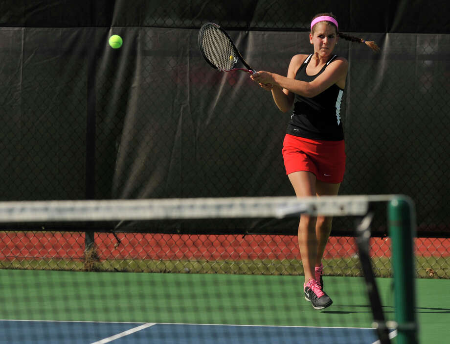 New Canaan's Kristin Laub returns the ball to the Greenwich side during their doubles tennis match at New Canaan High School on Tuesday, April 9, 2013. Photo: Jason Rearick / The (Stamford) Advocate