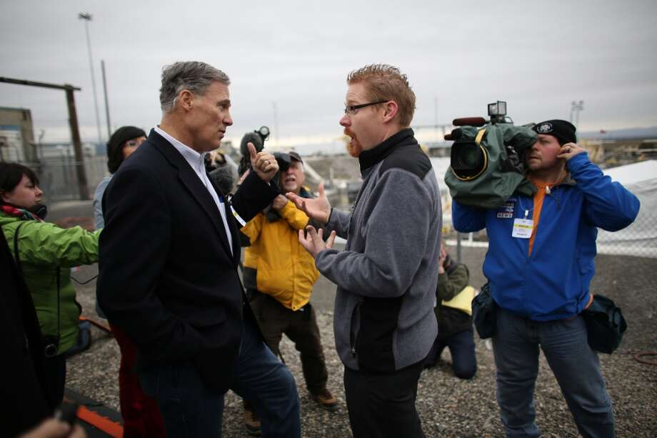 "Tom Fletcher, assistant manager of tank farms, addresses Governor Jay Inslee during a tour of a tank ""farm"" of the Hanford Nuclear Reservation near Richland. (Joshua Trujillo, seattlepi.com)"