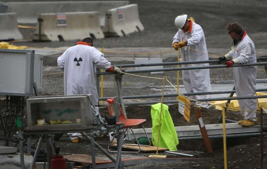 Workers are shown in a contaminated area at C-Tank Farm during a tour of the Hanford Nuclear Reservation near Richland on Wednesday, March 6, 2013. Tanks holding nuclear waste at the facility have been discovered in recent weeks to be leaking radioactive waste into the ground. The leaks have been discovered to be occurring at a far higher rate than previously believed. (Joshua Trujillo, seattlepi.com)