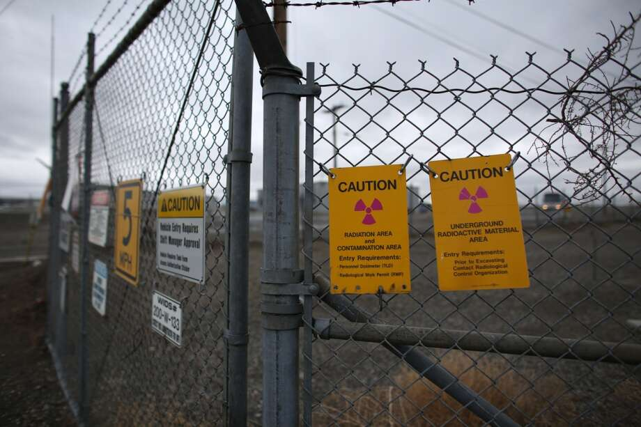"Signs warn of a contaminated area at a tank ""farm"" during a tour of the Hanford Nuclear Reservation near Richland."
