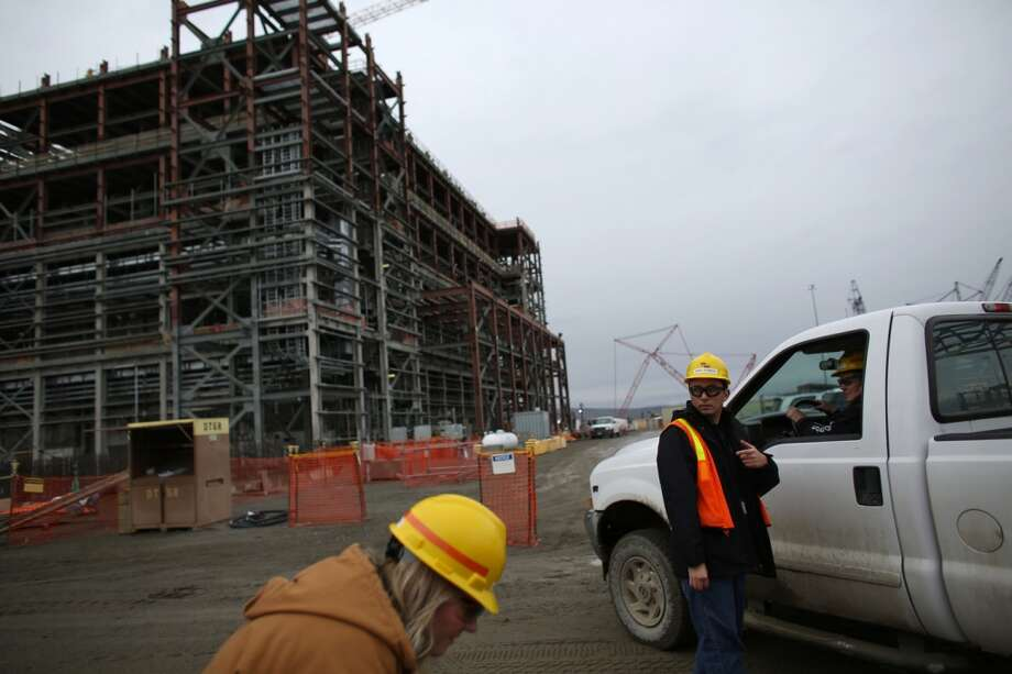 Worker are shown in front of the under-construction pre-treatment radioactive waste facility at Hanford Nuclear Reservation near Richland. (Joshua Trujillo, seattlepi.com)