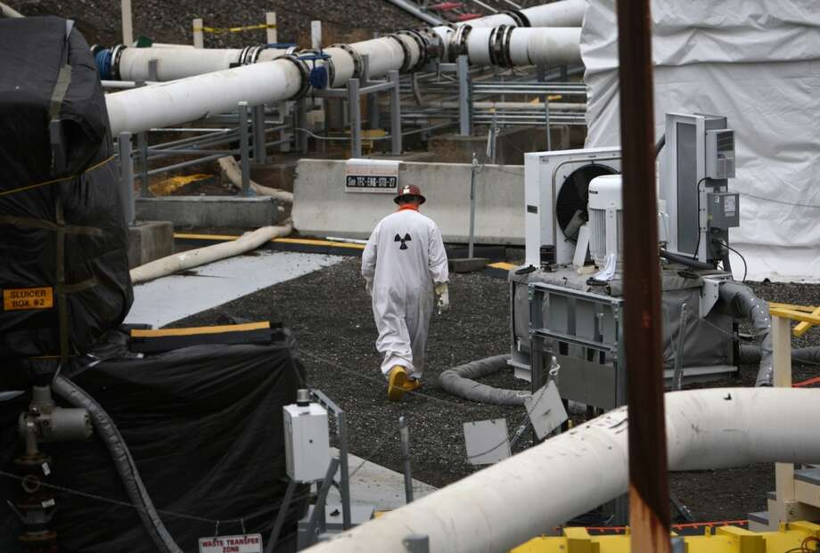 "A worker walks in a contaminated area of a tank ""farm"" as seen during a tour of the Hanford Nuclear Reservation near Richland. (Joshua Trujillo, seattlepi.com)"