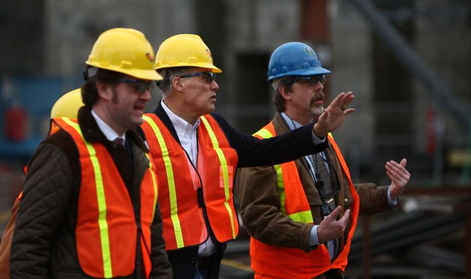Washington Governor Jay Inslee, second from right, is given a tour of an under-construction nuclear waste treatment facility at Hanford Nuclear Reservation. (Joshua Trujillo, seattlepi.com) Congress' stmulus bill will keep paychecks coming for those Hanford workers who can't work at home during the COVID-19 pandemic shutdown.