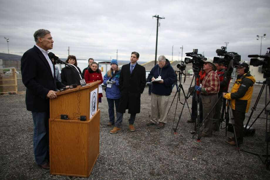 Governor Jay Inslee speaks during a press event at C-Tank Farm during a tour of the Hanford Nuclear Reservation near Richland on Wednesday, March 6, 2013. Communications aide Jaime Smith set up event on the fly, as Inslee lamented slow pace of Hanford cleanup.