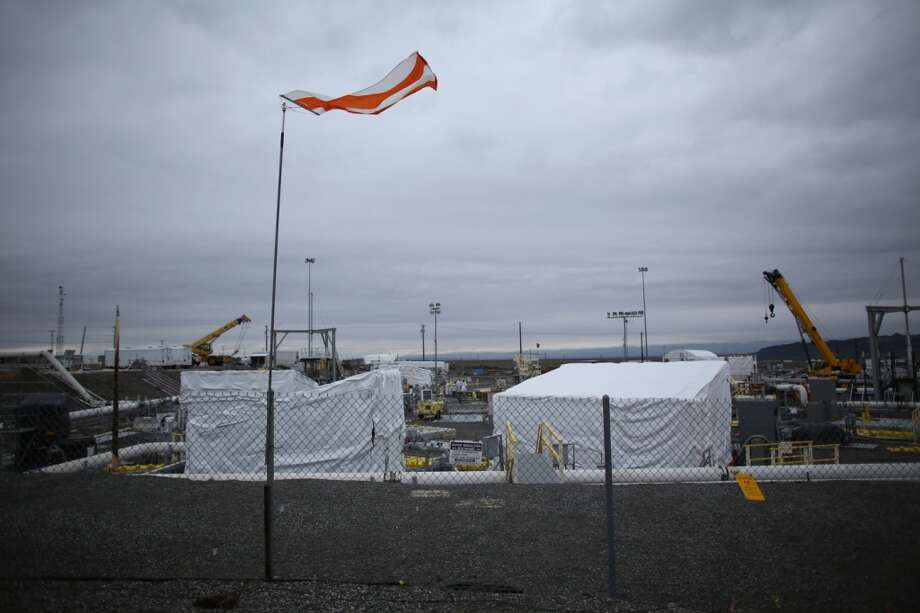 A flag flaps at C-Tank Farm during a tour of the Hanford Nuclear Reservation near Richland on Wednesday, March 6, 2013. Tanks holding nuclear waste at the facility have been discovered in recent weeks to be leaking radioactive waste into the ground. The leaks have been discovered to be occurring at a far higher rate than previously believed. (Joshua Trujillo, seattlepi.com)
