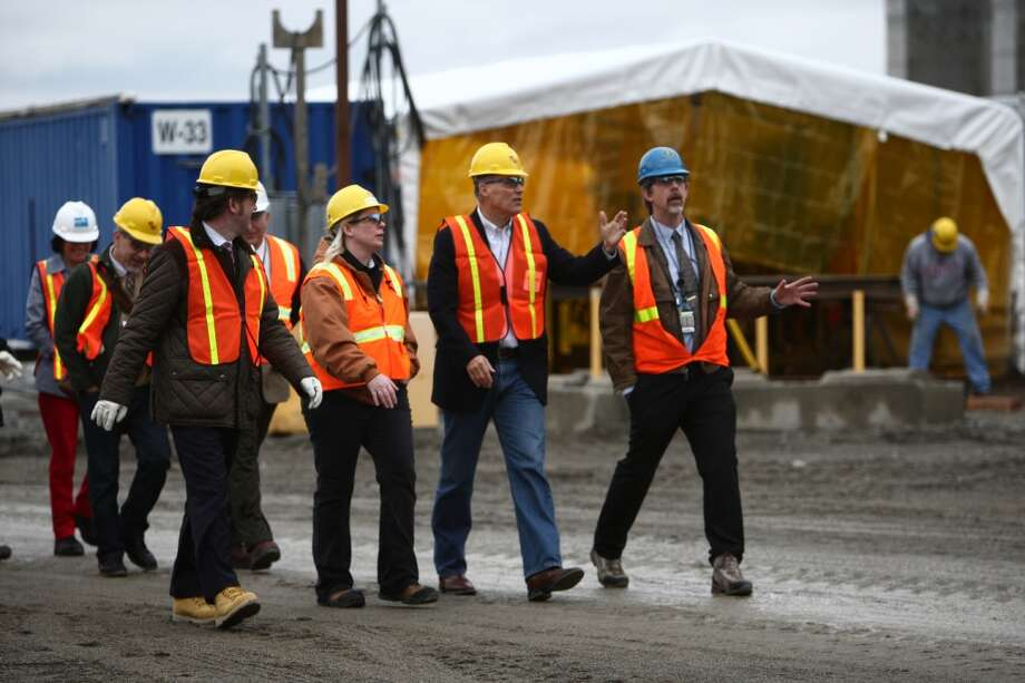 Washington Governor Jay Inslee, second from right, is given a tour of an under-construction nuclear waste treatment facility at Hanford Nuclear Reservation near Richland on Wednesday, March 6, 2013. Tanks holding nuclear waste at the facility have been discovered in recent weeks to be leaking radioactive waste into the ground. The leaks have been discovered to be occurring at a far higher rate than previously believed. (Joshua Trujillo, seattlepi.com)