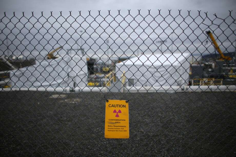 Signs warn of a contaminated area at C-Tank Farm during a tour of the Hanford Nuclear Reservation near Richland on Wednesday, March 6, 2013. Tanks holding nuclear waste at the facility have been discovered in recent weeks to be leaking radioactive waste into the ground. The leaks have been discovered to be occurring at a far higher rate than previously believed. (Joshua Trujillo, seattlepi.com)