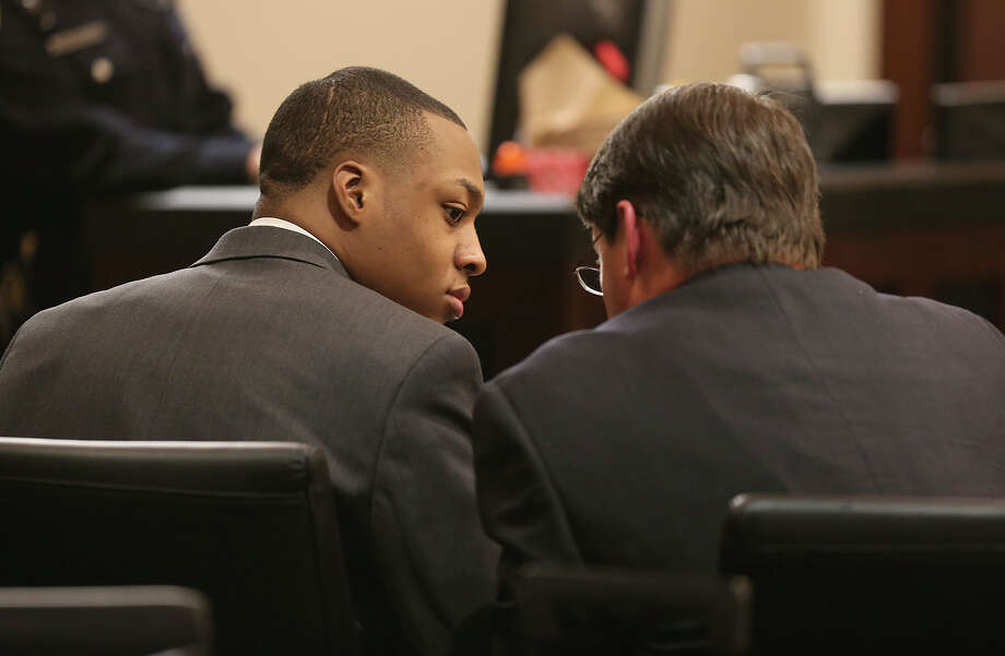 Anthony Johnson, 23, waits for the jury to return after reaching a verdict during his murder trial in Bexar County District Court. Photo: Jerry Lara, San Antonio Express-News / ©2013 San Antonio Express-News
